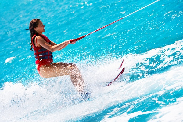 Portrait of a beautiful young woman water skiing